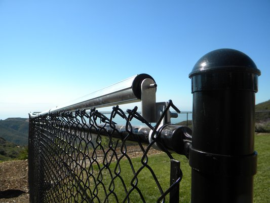 Coyote Rollers on Fence